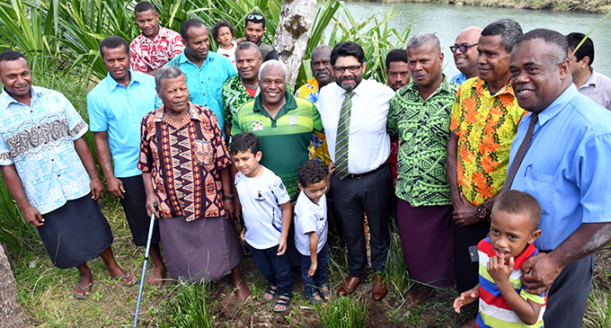 Attorney-General Aiyaz Sayed-Khaiyum with Naveicovatu villagers of Tailevu and his sons, Ibrahim and Idris, on September 10, 2019 following the launch of the Global Commission and Adaptation Flagship Report.   Photo: Ronald Kumar