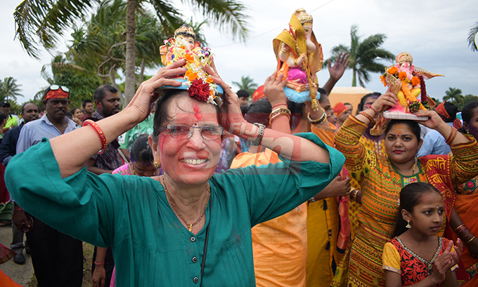 Rekha Patel (left) together with hundreds of devotees carry the Lord Ganesha idol to mark the final ritual of Ganesh Utsav (Lord Ganesha prayer) at My Suva Park on September 12, 2019. Photo: Ronald Kumar.