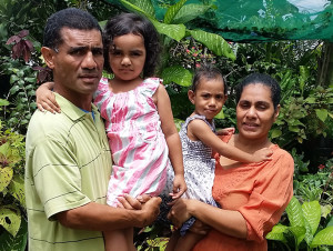 Mausio Susau (left) with his wife, Magirita Susau (right) and their children at their flower garden. Photo: Maika Bolatiki