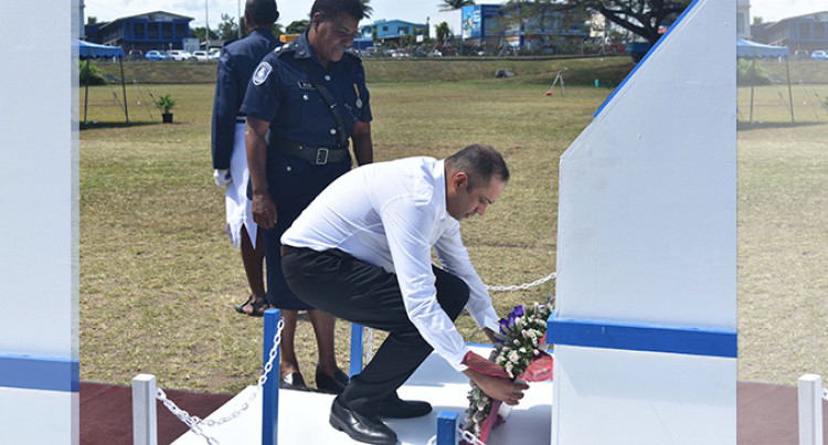 Khan Comforts Fallen Police Officers' Families