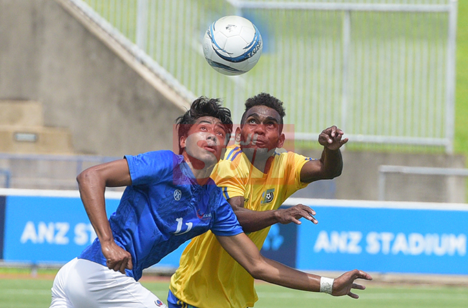 Samoa's Ronnie Bourne battle for possession against  Molis Gagame Jr. of Solomon Island during OFC Men's Olympic qualifier 2019 group a match at ANZ Stadium on September 24, 2019. Photo: Ronald Kumar.