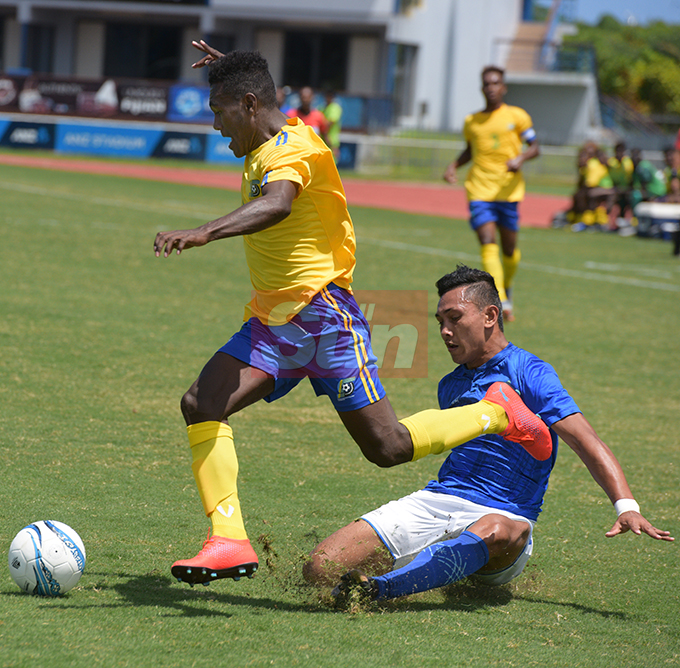 Adrian Mara of Solomon Island wins possession over  Samoa's David Junior during OFC Men's Olympic qualifier 2019 group a match at ANZ Stadium on September 24, 2019. Photo: Ronald Kumar.