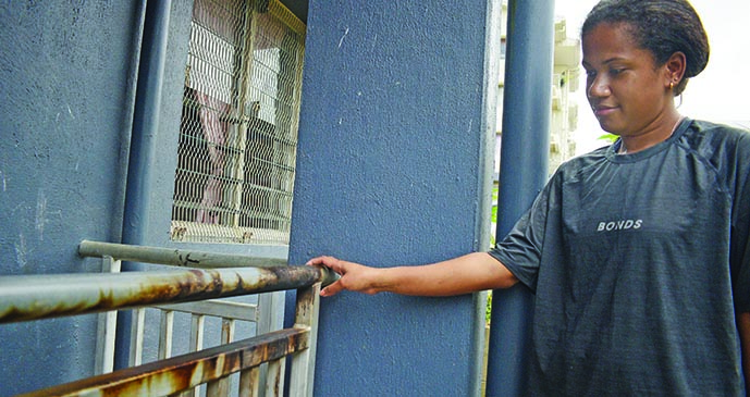 Esita Marama shows the burned railing outside her Public Rental Board Raiwai flat on September 25, 2019. Photo: Ronald Kumar