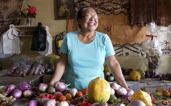 Teresa Yee Show inside the shop where she sells farm produce for market vendors in Levuka.
