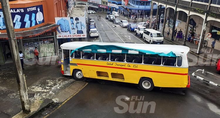 Bus Slams Into Signpost, No One Injured