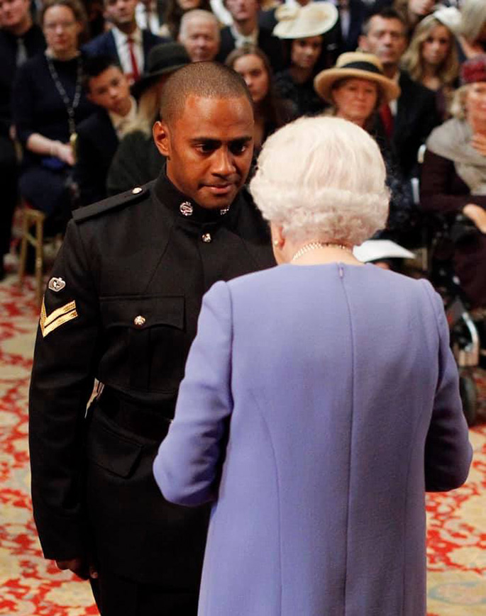 Fijian-born Corporal Saimone Qasenivalu of the British Armed Forces with Her Majesty Queen Elizabeth in London, England