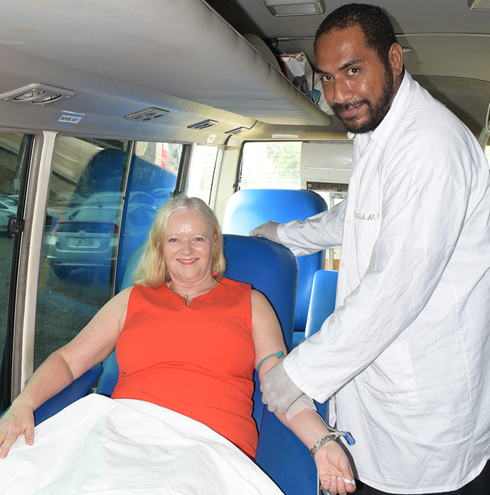 Blood Bank Lab Technician Jolame Kauloto (right) assists Ministry for Health  Permanent Secretary Bernadette Welch in donating blood at the Ministry of Health Blood drive campaign in Suva on October 1, 2019.  Photo: Ronald Kumar