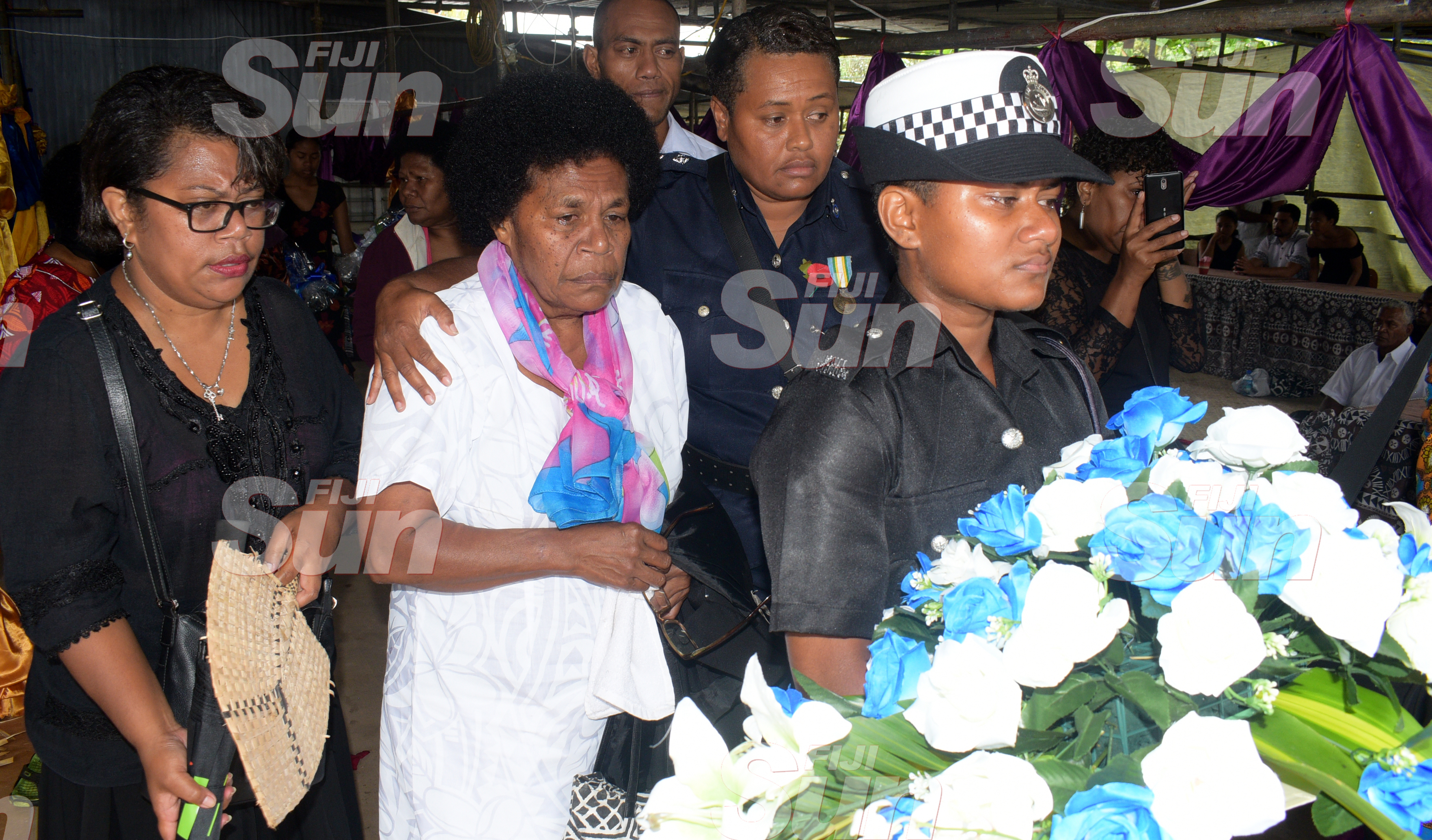 Late Constable Siuta Niumataiwalu's Mother, Makereta Koroi 66 (second from left) is consoled by Inspector Mariana Bulatolu during the funeral service at Evergreen AOG Church in Nasinu on October 26, 2019. Photo: Ronald Kumar.