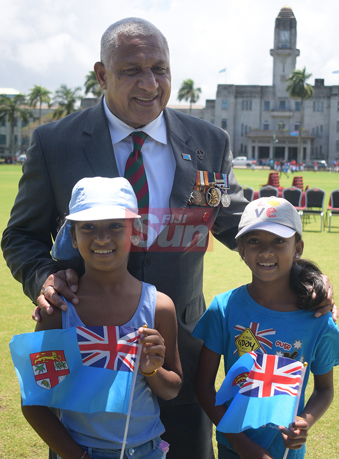 Prime Minister Voreqe Bainimarama with sister's Saanvi and Sahana Naidu following the Fiji Day Parade at Albert park on October 10, 2019. Photo: Ronald Kumar.