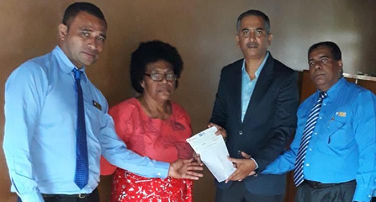 Mother Of Late Slain Cop, Niumataiwalu, Gets Insurance Pay