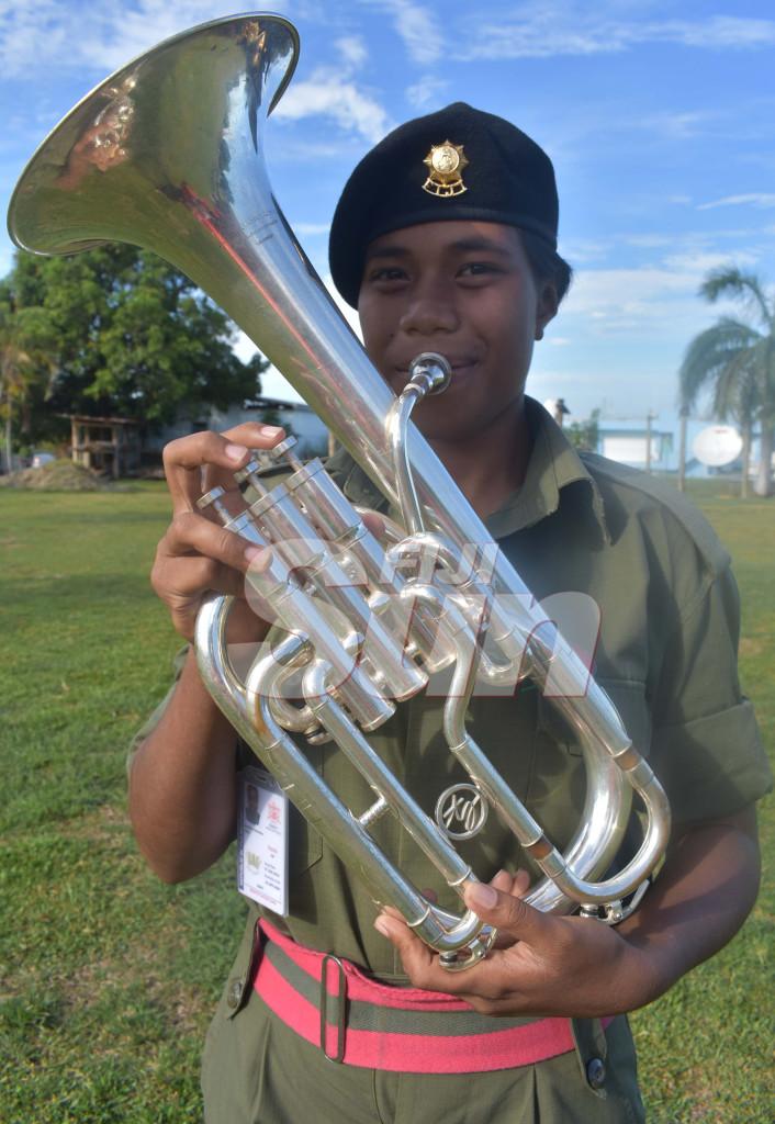 Ordinary Seaman Analisa Tieti with the horn she plays. Photo: Waisea Nasokia