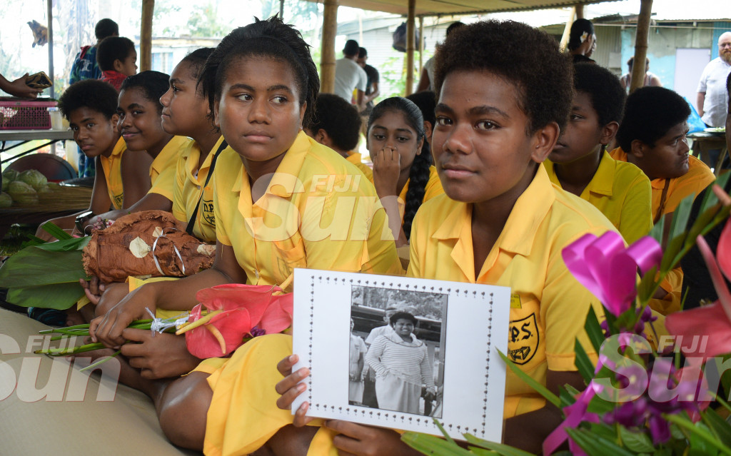 Lavenia Tepola (right) a year eight students of Nausori Primary School with fellow students during the funeral of their class mate Makreta Mataika, who died in bus accident in Lakena. Photo: Ronald Kumar.