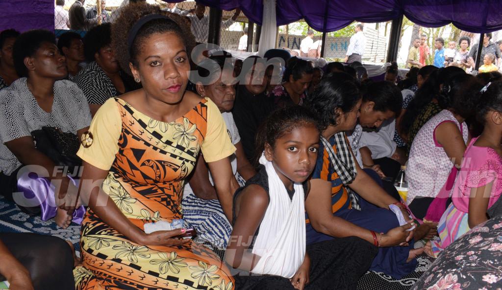 Lakena bus accident survivor Liliviwa Ako, 9, with her mother Joana Momo during Makereta Miriama Mataika's funeral service on October 15, 2019. Photo: Ronald Kumar