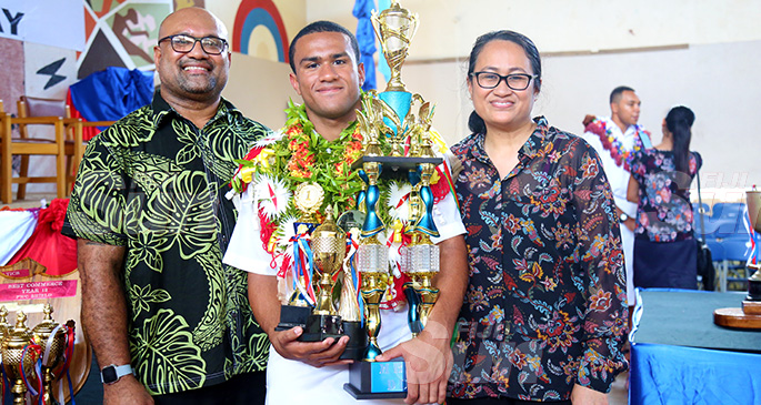 Dux Award recipient Temafa Yalimaiwai with parents Banuve and Emily Yalimaiwai with his trophies after the prize giving ceremony on October 11, 2019. Photo: Kelera Sovasiga