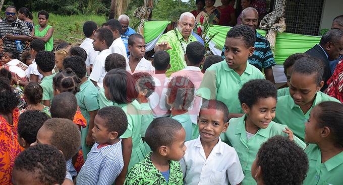 Prime MInisyter Voreqe Bainimarama with Ratu Veikusu Primary School student in Buretu Tailevu after opening the teachers quarters on October 22, 2019. Photo: Ronald Kumar.