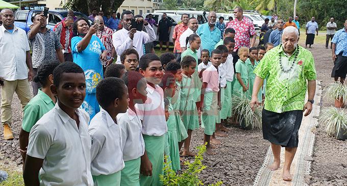 Prime MInister Voreqe Bainimarama with Ratu Veikusu Primary School student in Buretu Tailevu after opening the teachers quarters on October 22, 2019. Photo: Ronald Kumar.