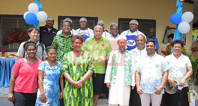 Prime Minister Voreqe Bainimarama with Ministry of Indrustry Trade ansd Tourism staff anmd Cautata bakery staff following the opening on October 22, 2019. Photo: Ronald Kumar.