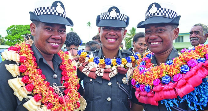 It was a dream come true for these three cousins, (from left:) Ilisapeci Tobeyaweni, Miliame Qasi and Alena Caginitoba at the Police passing out parade at the Nasova Police Academy on October 18, 2019. Photo: Ronald Kumar