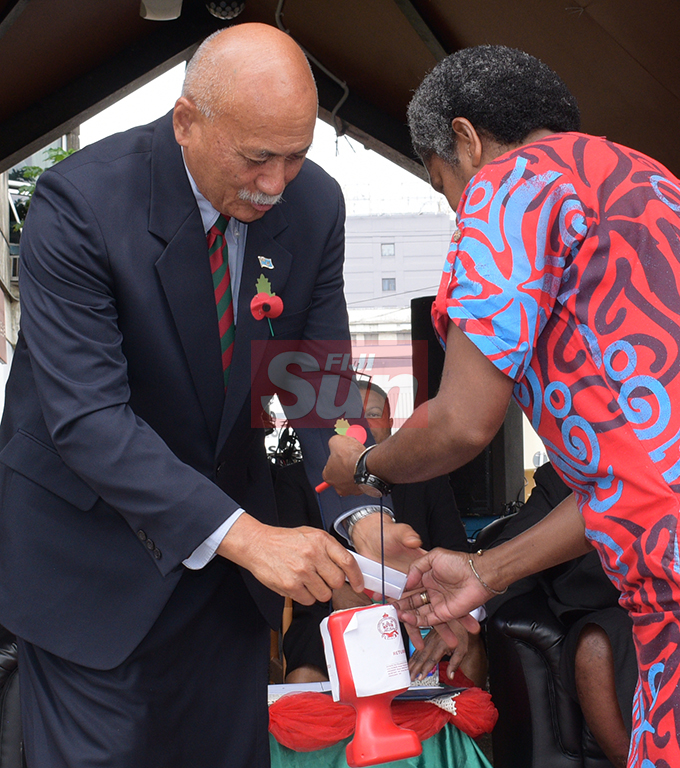 President Jioji Konrote donates to launch the Poppy Appeal at Ratu Sukuna Park on October 4, 2019.Photo: Ronald Kumar.
