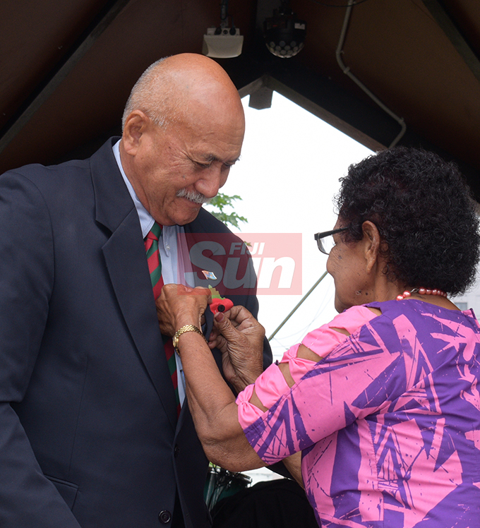 President Jioji Konrote gets his poppy flower from ex-serviceman association member Ecela Vakacokaivalu during the launching of Poppy Appeal at Ratu Sukuna Park on October 4, 2019.Photo: Ronald Kumar.