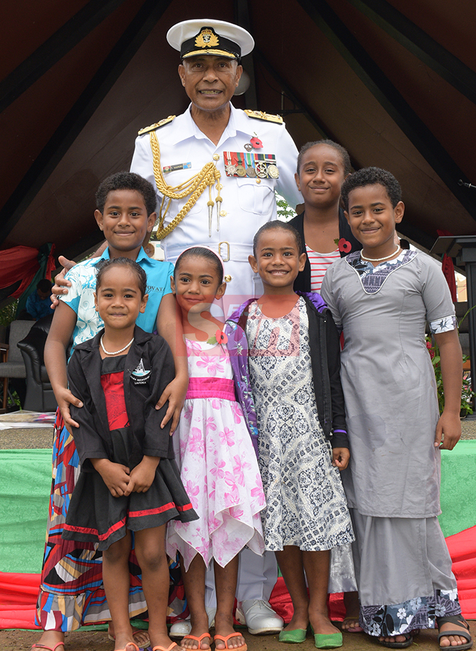 Republic of Fiji Military Forces (RFMF) Commander Rear Admiral Viliame Naupoto with grand children of ex-serviceman Late Col. Samisoni Waqavakatoga during the launching of Poppy Appeal at Ratu Sukuna Park on  October 4, 2019.Photo: Ronald Kumar.
