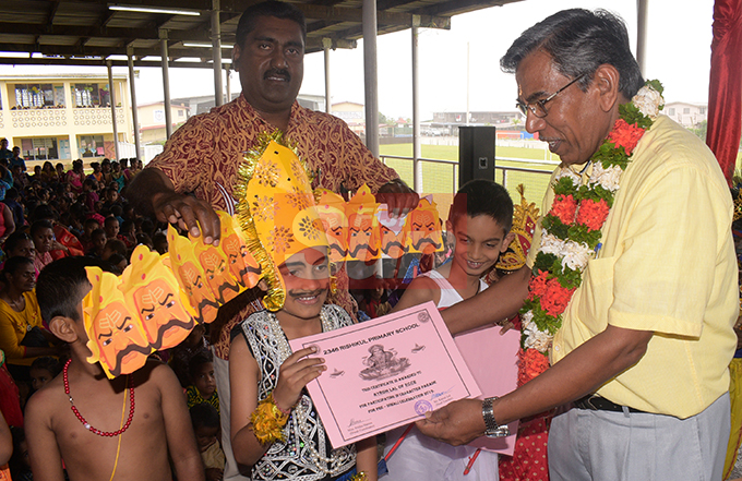 Professor Surendra Prasad (right) awards Ayron Lal (dressed as King Ravana) and other Rishikul Primary School best Diwali dressed students as Head Teacher Kamal Lal (left) look on October 25, 2019. Photo: Ronald Kumar.