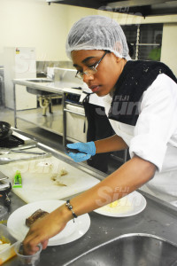Fiji National University second year student, Merewalesi Banuve preparing her teriyaki surf and turf during the competition on October 22, 2019. Photo: Nicolette Chambers