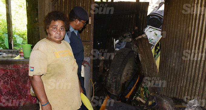 Ani Katonivere (left) is lucky to be alive as the a bus veered of the road and landed on her house killing two passengers in the bus at Lakena Hill in Nausori on 9 October, 2019. Photo: Ronald Kumar