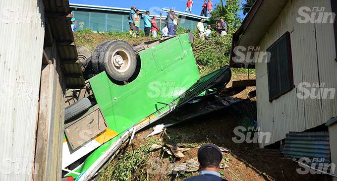 Two school children, who were passengers in this Zakreen Holdings Ltd bus, died after it slid off the road and landed on a house at Lakena Hill in Nausori on October 9, 2019. Photo: Ronald Kumar.