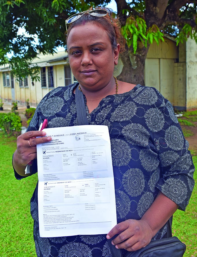 Shalini Deo showing her ticket which she had paid for at Go Local Holidays in Martintar, Nadi. Photo: Nicolette Chambers