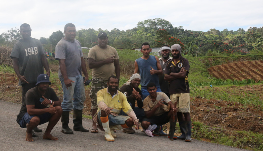 Anasa Tawake (standing third from left) with some of his workers. Photo: Ivamere Nataro
