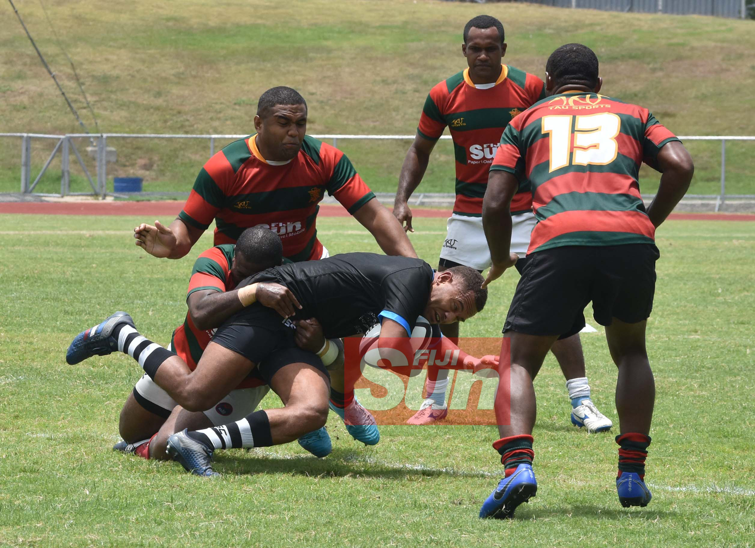 Flying Fijians Cyril Reece is tackled by RFMF team during training at the Churchill park, Lautoka yesterday. Photo: WAISEA NASOKIA