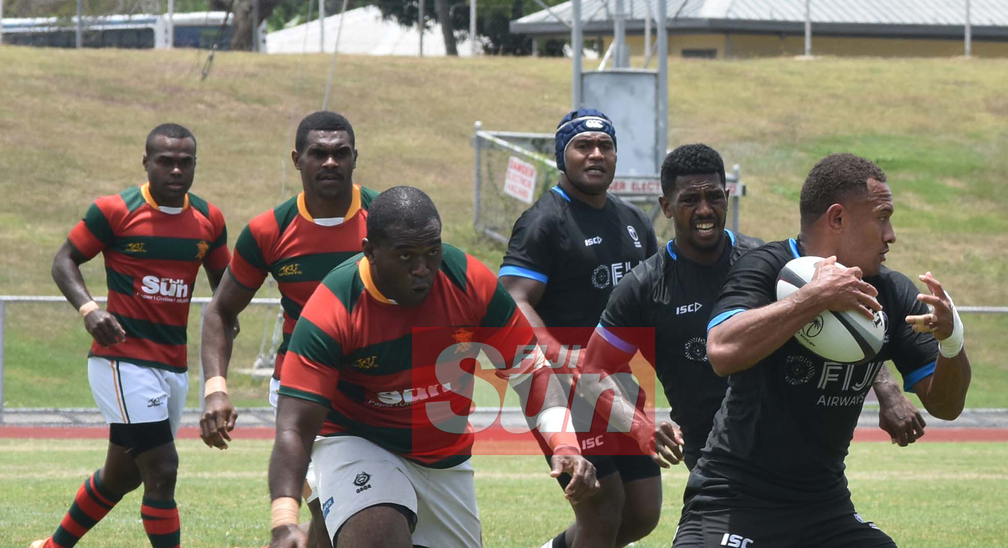 Flying Fijians Cyril Reece in the attack against RFMF team during training at the Churchill park, Lautoka yesterday. Photo: WAISEA NASOKIA