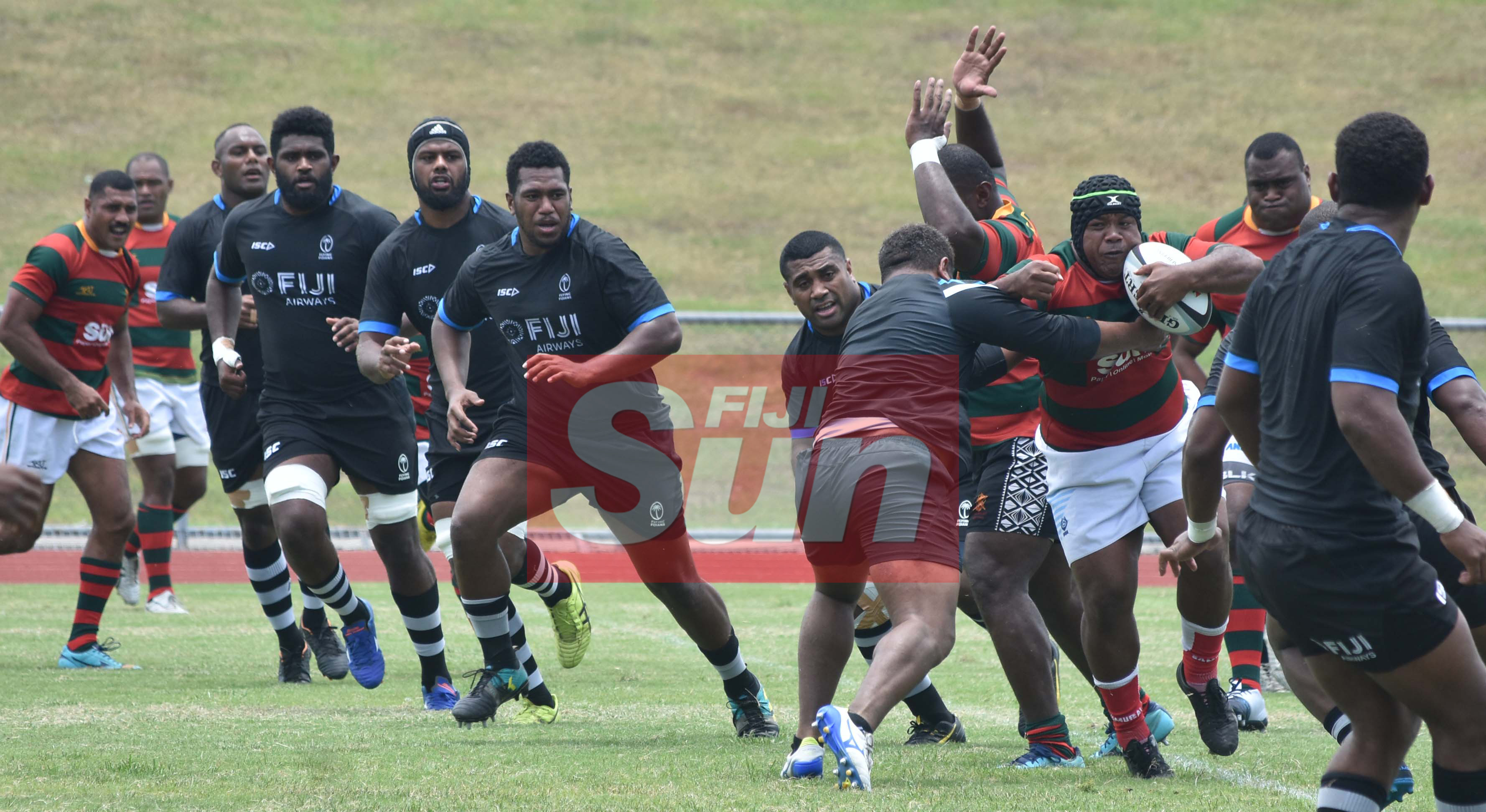Flying Fijians defends against RFMF team during training at the Churchill park, Lautoka yesterday. Photo: WAISEA NASOKIA