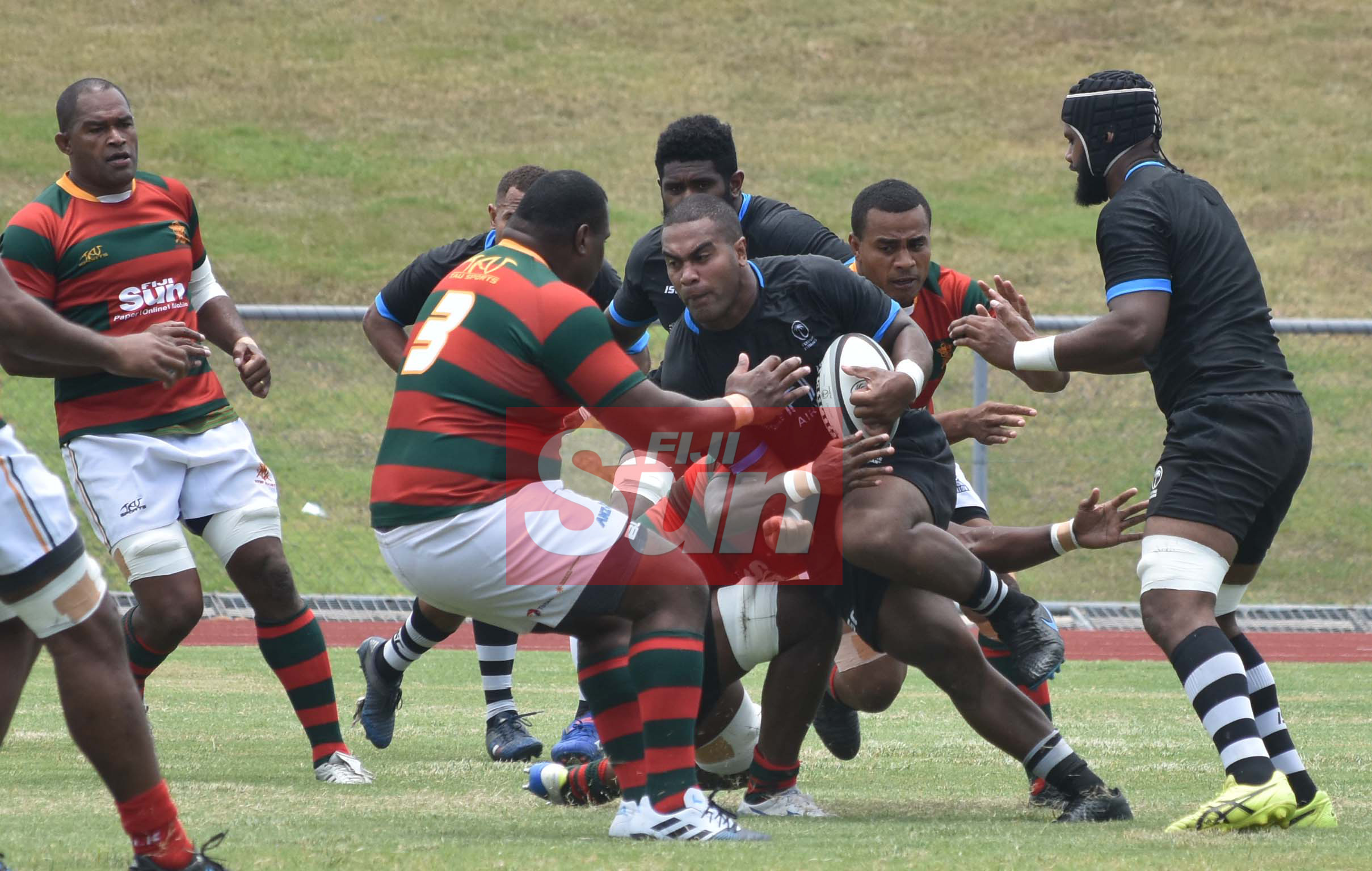 Flying Fijians Johnny Dyer on the attack against RFMF team during training at the Churchill park, Lautoka yesterday. Photo: WAISEA NASOKIA