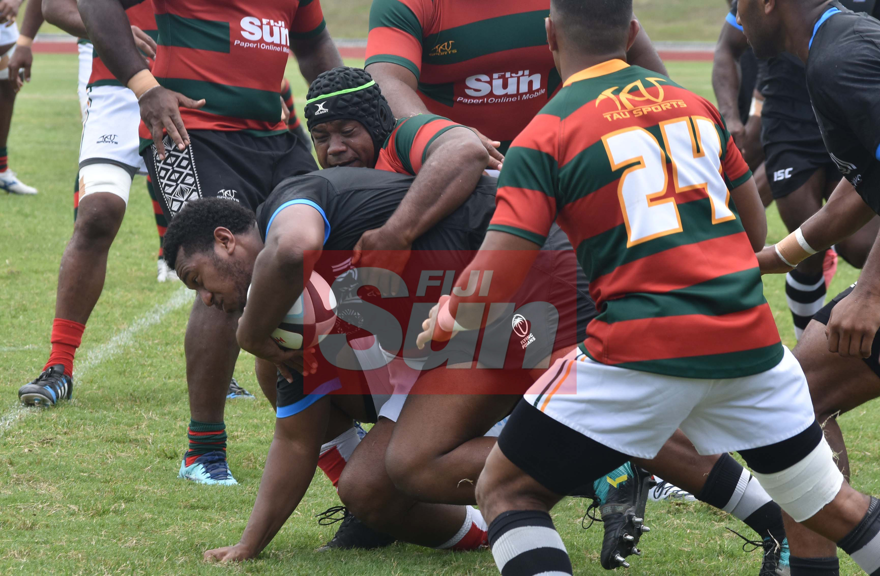 Flying Fijians Eroni Mawi attack against RFMF team during training at the Churchill park, Lautoka yesterday. Photo: WAISEA NASOKIA
