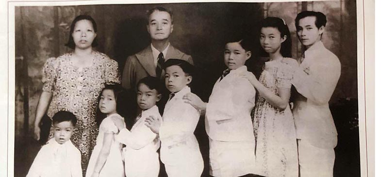 Standing at the Back: the late Mr and Mrs Ham Bing Nam. From left: The Harm Nam siblings: Edward, Rosie, Arthur, Victor, George, Annie and Ivan.