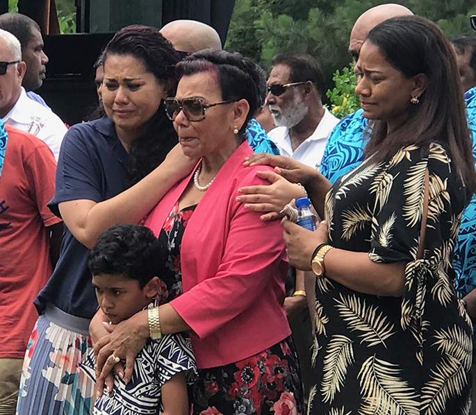 Margaret Elisha, centre, holding grandson Amani Jan and flanked by her daughters Bernadine, left and Davina at the funeral of her late husband Daniel Elisha in Ba on November 5, 2019. Photo: Charles Chambers