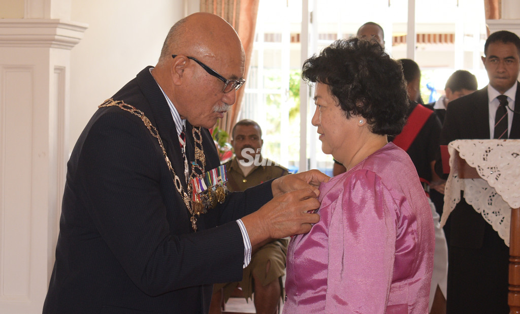 Jenny Seeto received officer of the Order of Fojin medal from President Major-General (Ret'd)Jioji Konrote during Order of Fiji investiture ceremony at State House on November 29, 2019. Photo: Ronald Kumar.