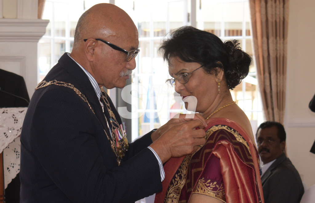 Dr. Sarawati Nandan received Member of the Order of Fiji (MF) from President Major-General (Ret'd)Jioji Konrote during Order of Fiji investiture ceremony at State House on November 29, 2019. Photo: Ronald Kumar.