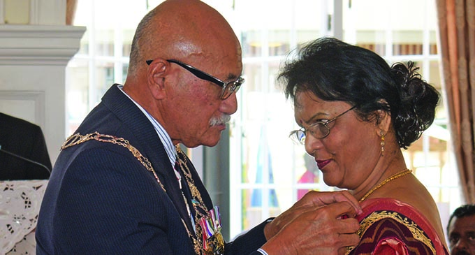 Dr. Saraswati Nandan received the Member of the Order of Fiji (MF) from the President Major-General (Ret'd) Jioji Konrote during the Order of Fiji Investiture ceremony at State House on November 29, 2019.  Photo: Ronald Kumar
