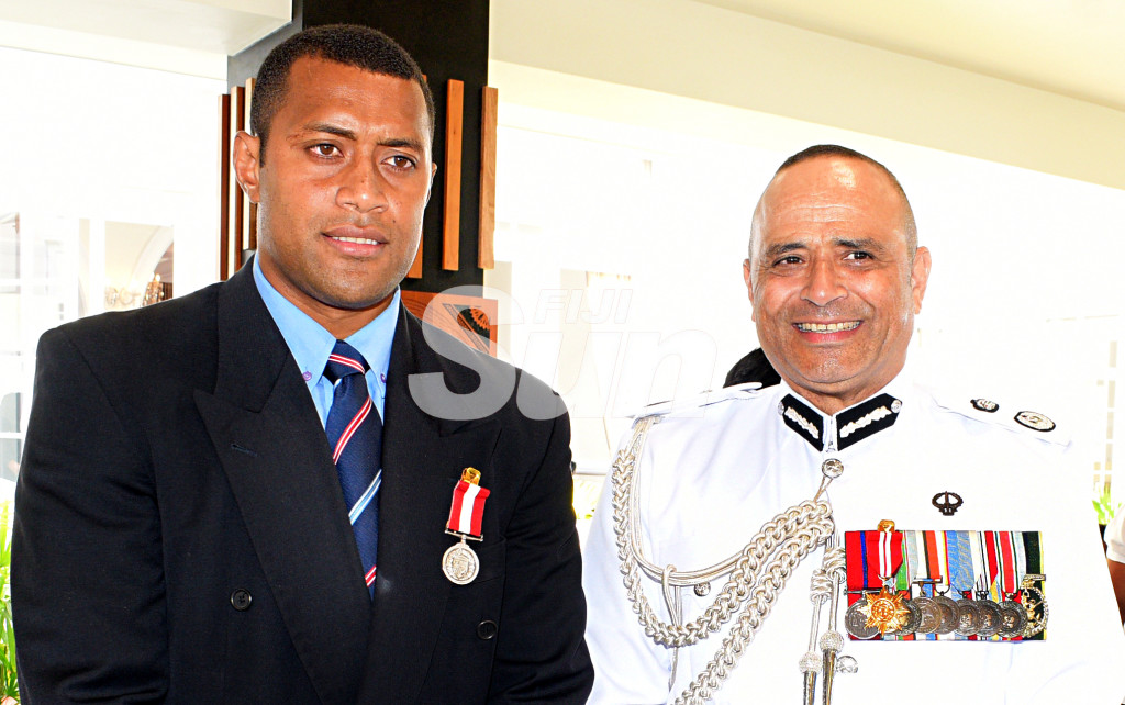 Former National Sevens rep, Samisoni Viriviri (left) and Police Commissioner Brigadier-General Sitiveni Qiliho after receiving medals from President Major-General (Ret'd)Jioji Konrote during Order of Fiji investiture ceremony at State House on November 29, 2019. Photo: Ronald Kumar.