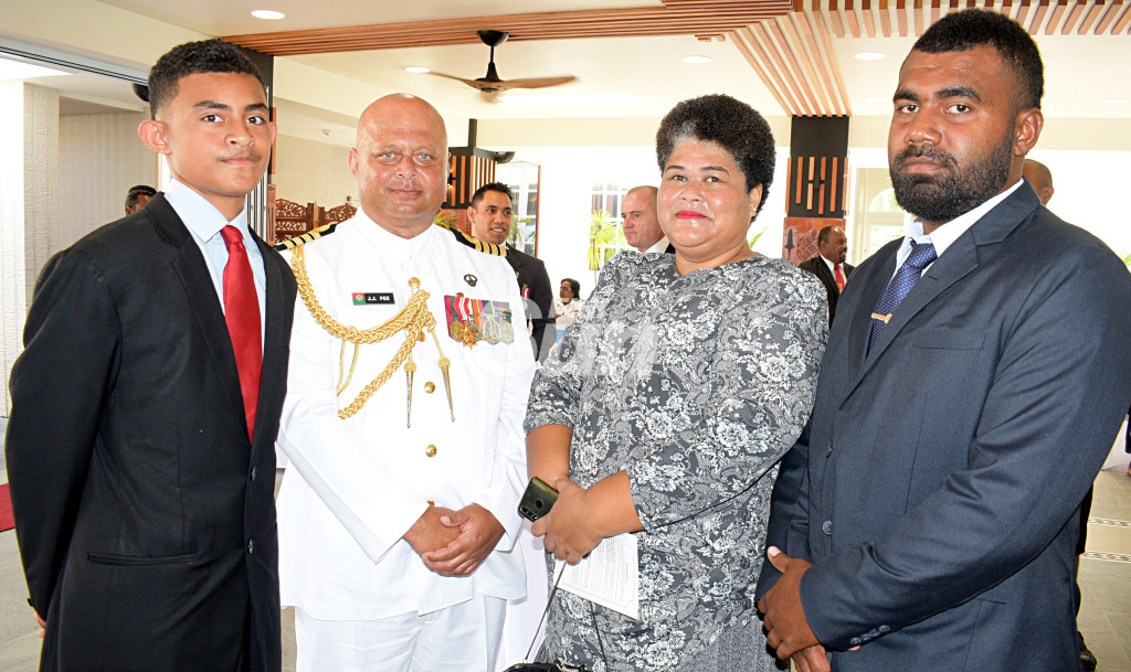 Captain (Navy) John Fox (second from left) with family, William Fox, Akesa Fox and John Fox (jr) after receiving Officer of the Order of Fiji (OF) medal from President Major-General (Ret'd)Jioji Konrote during Order of Fiji investiture ceremony at State House on November 29, 2019. Photo: Ronald Kumar.