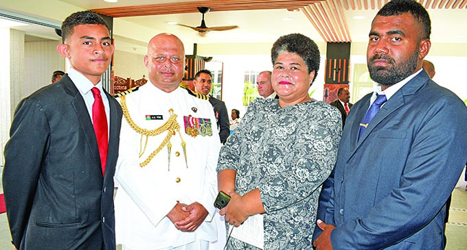 Captain (navy) John Fox (second from left) with his family members William Fox, Akesa Fox and John Fox (jr) after receiving his  Officer of the Order of Fiji (OF) medal from the President, Major-General (Ret'd) Jioji Konrote, during the Order of Fiji Investiture Ceremony at the State House on November 29, 2019. Photo: Ronald Kumar