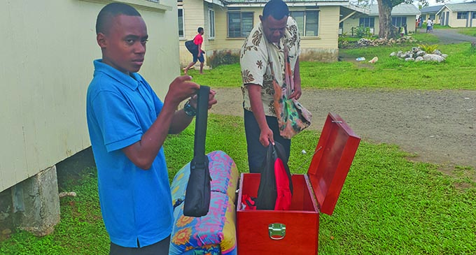 A happy Ratu Kadavulevu School student with his boarding gear and new wooden chest donated by the Ministry of Forestry on November 8, 2019. Photo: Ministry of Forestry