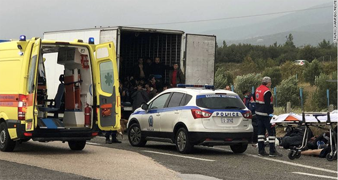 People are seen inside a refrigerated truck found by the police near Xanthi, Greece. Photo: CNN
