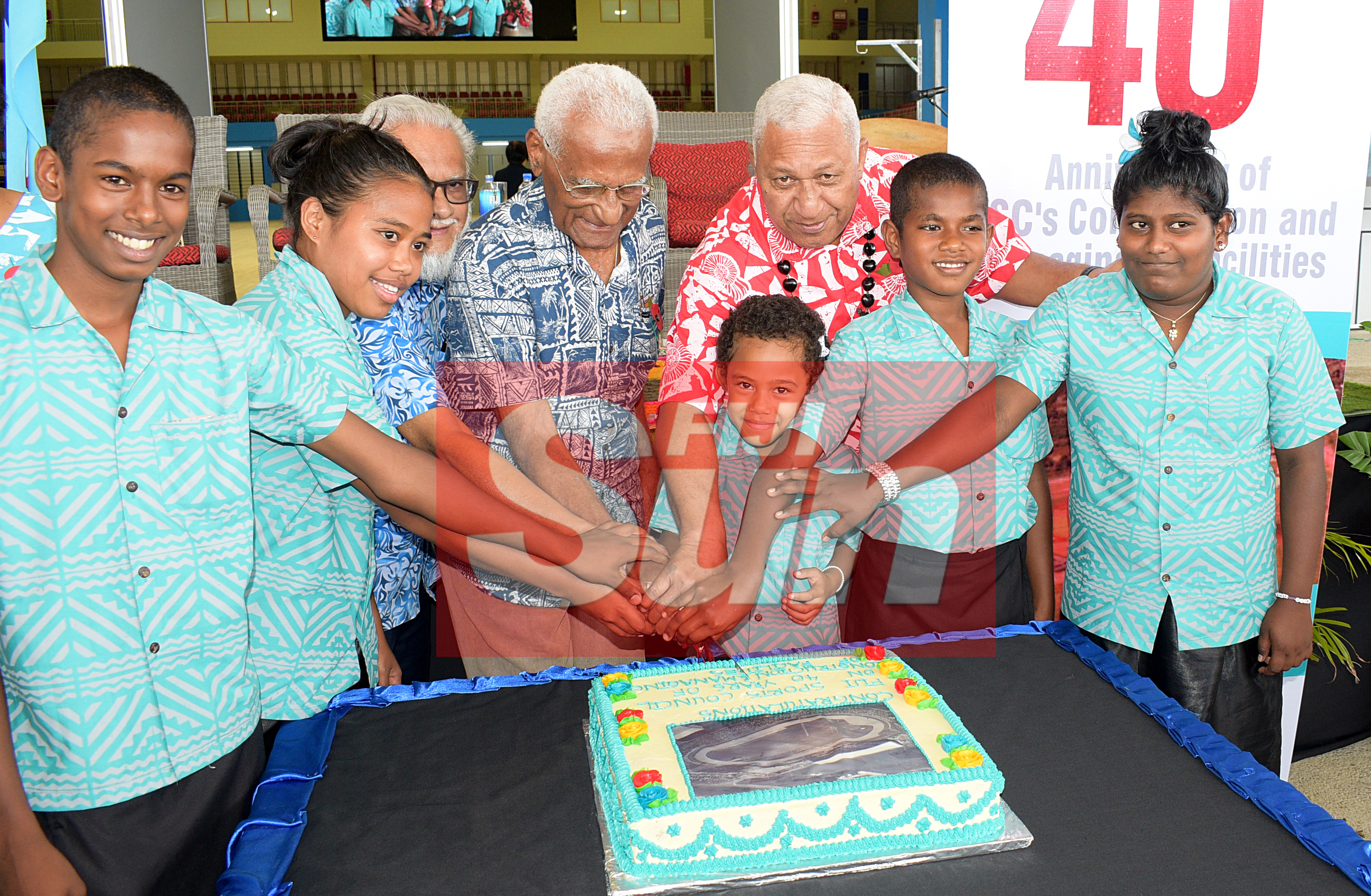 Prime Minister Voreqe Bainimarama, former Fiji Sports Council board members, Ikbal Jannif and Manu Korovulavula and St. Christopher home children cut the cake to make 40 years of Fiji Sports Council and re-opening of renovated Vodafone Arena on November 8, 2019. Photo: Ronald Kumar.
