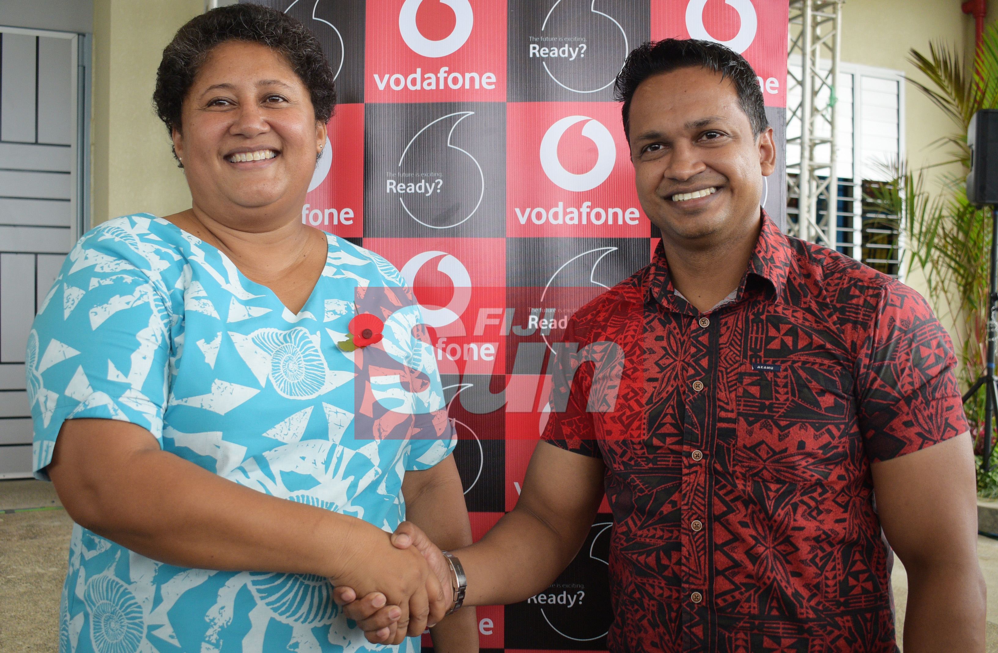 Fiji Sports Council Chief Executive Officer, Litiana Loabuka (left) with Vodafone Chief Marketing Officer Rajnesh Prasad after signing three year naming right of Vodafone Arena on November 8, 2019. Photo: Ronald Kumar.