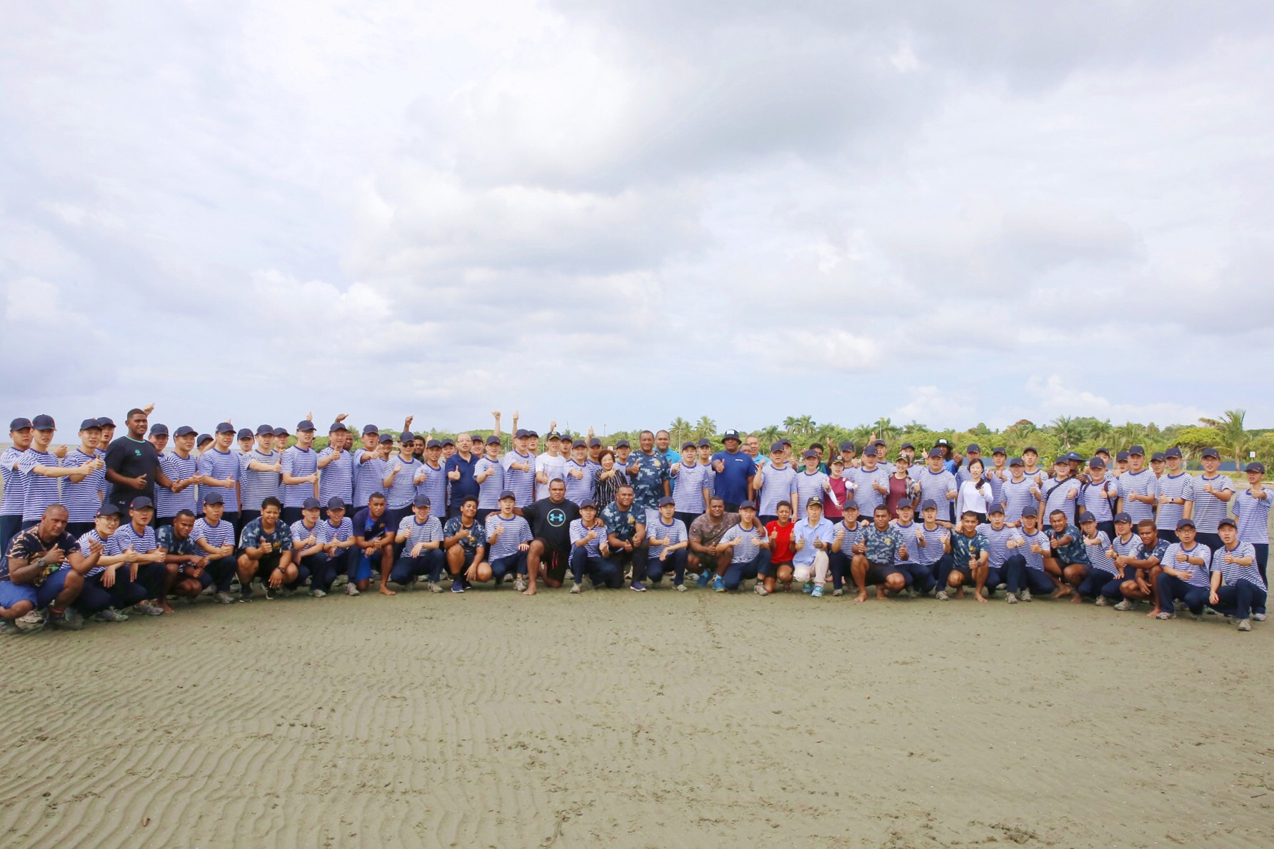 The Ministry of Forest alongside the Chinese Navy during a mangrove planting session at the Suva Foreshore.