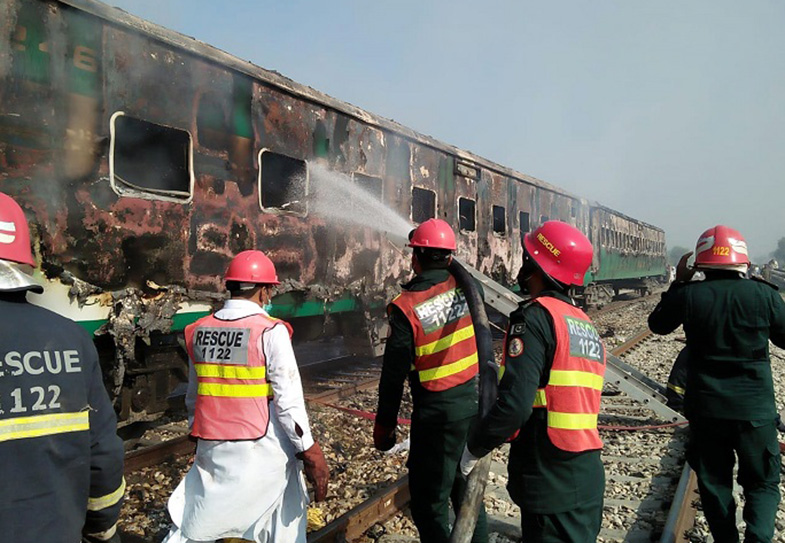 Rescuers working after a passenger train caught fire in Rahim Yar Khan district of Pakistan's east Punjab province on Oct. 31, 2019.